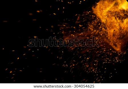 sparks of fire on a black background