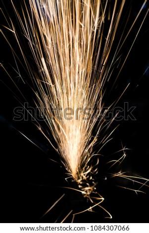 Sparks on a black background fly up.