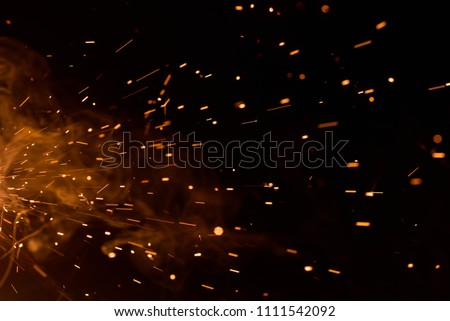 Sparks on black background from welding of steel