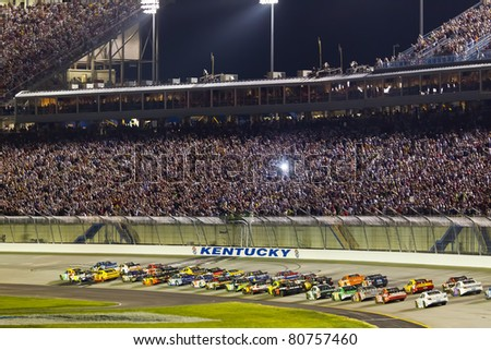 SPARTA, KY - JULY 09:  The NASCAR Sprint Cup Series teams take to the track for the Quaker State 400 race at the Kentucky Speedway in Sparta, KY on July 09, 2011. - stock photo