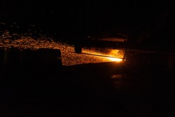Spatter of Hot Molten Metal During Cast Iron Piercing. Metallurgical industry. Web Banner.