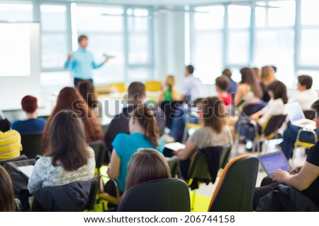 Shutterstock Speaker at business workshop and presentation. Audience at the conference room.