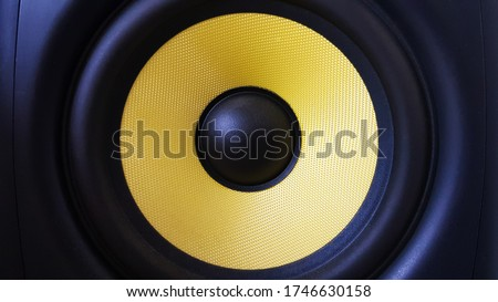 Speaker background. Woofer, yellow subwoofer close-up. Professional studio equipment. Vocal monitor for mixing and recording music. High quality desk monitors Сток-фото ©