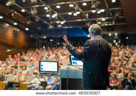 Speaker giving a talk on corporate Business Conference. Audience at the conference hall. Business and Entrepreneurship event. Stock photo ©