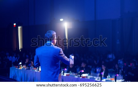 Speaker giving a talk on corporate Business Conference hall or seminar room background. meeting, event, business, presentation, exhibition. #695256625