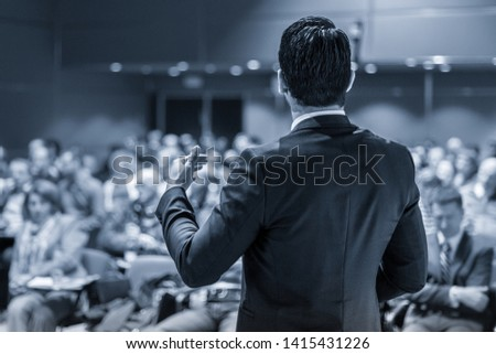 Speaker giving a talk on corporate business conference. Unrecognizable people in audience at conference hall. Business and Entrepreneurship event. #1415431226