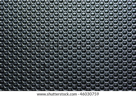 Speaker grille with circle pattern.