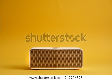 Speaker on yellow background. #747926578
