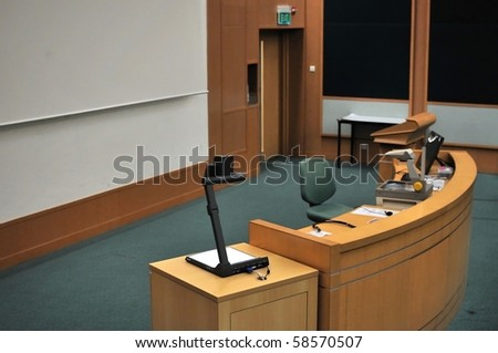 Speaker's stand in lecture hall. For concepts such as school and education, business and training, and meetings and conferences.