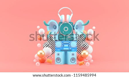 Speakers, radios, turntables and headphones among colorful balls on the pink background.-3d rendering.