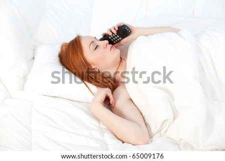 speaking on the phone woman in white bedding