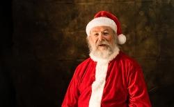 Speaking Santa Claus on dark studio background