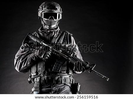 Spec ops police officer SWAT in black uniform studio Free