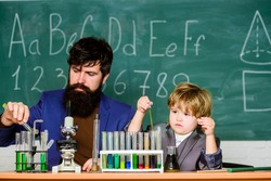 Special and unique. Genius kid. Joys and challenges raising gifted child. Teacher bearded scientist man child test tubes. Chemical experiment. Genius child private lesson. Knowledge day. Genius minds