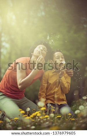 Special bond between son and mother. Mother and son in the park. #1376979605