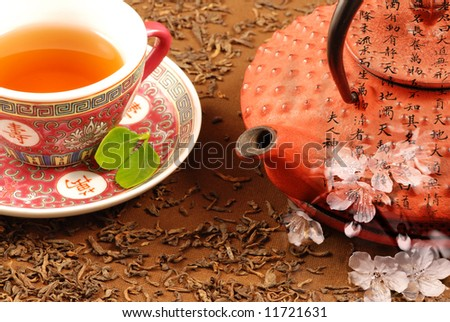 Special Chinese tea ceremony with kettle, calligraphy and cherry bloom