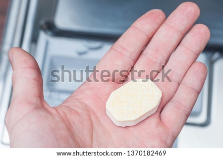 Special concentrated tablet for dishwasher in hand #1370182469