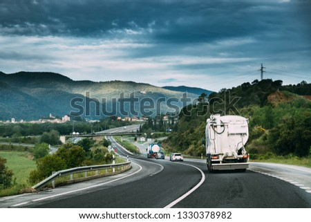 Special Concrete Transport Truck In-transit Mixer Unit In Motion On Country Road, Freeway. Freeway Motorway Highway. Business Drive Transportation And Development Concept. Concrete Truck Mixer #1330378982