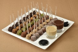 Special dates dessert (sweets made with dates) served with chocolate & caramel sauces, usually eaten with Arabic coffee, at parties and holidays . Feast dessert (Ramadan & Eid sweets)