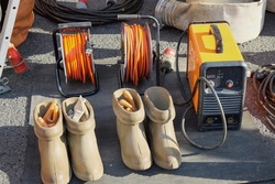 Special dielectric rubber boots and gloves designed to work with high voltage.High voltage protective insulating shoes and gloves