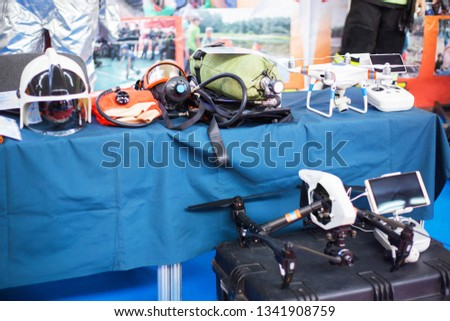 Special equipment of rescue worker - mask, helmet, drone, oxygen cylinder at emergency services show