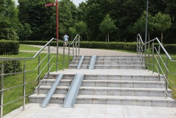 Special equipment on the stairs for strollers and bicycles. Rails on the stairs.