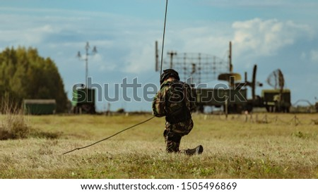 Special Forces descends the rope at a military airfield