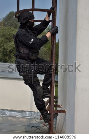 special forces officer climbs a ladder to the chimney, VIP protection, the observer