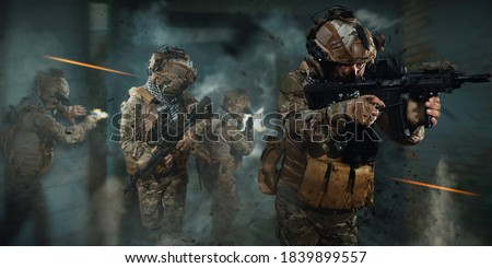 Photo of  special forces soldier in battlefield . modern warfare.