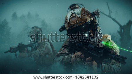 Photo of  special forces soldier in battlefield . modern warfare..