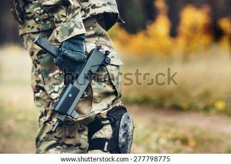 Special forces soldier with rifle in the forest