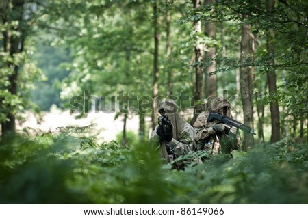special forces soldiers in forest
