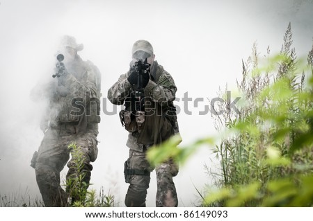 special forces soldiers walking in smoke