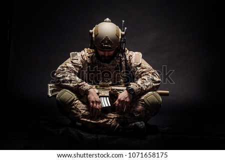 Special forces United States soldier or private military contractor with PTSD. Image on a black background.