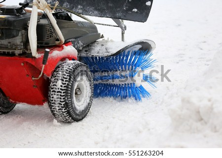 special machine for snow removal cleans the road #551263204