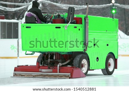 special machine ice harvester cleans the ice rink. winter specialized transport