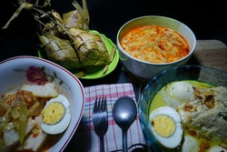 Special menu in Java, Indonesia when Eid Festival come: Opor Ayam, Sambal Goreng and Ketupat, strobist and night photography, selective focus, so Contrast, so grainy