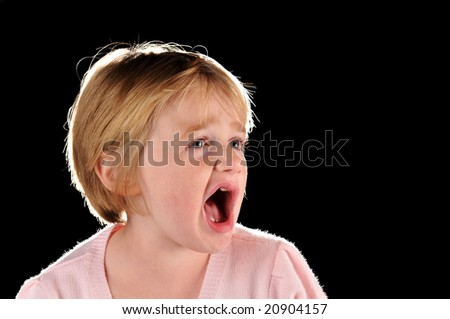 Special needs girl isolated against a black background