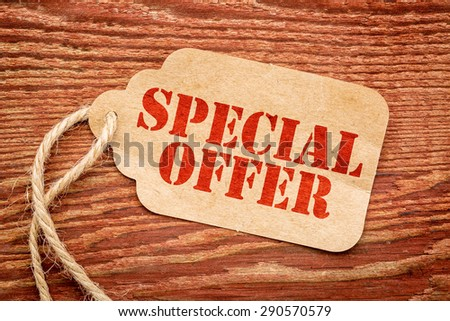 special offer sign a paper price tag against rustic red painted barn wood #290570579