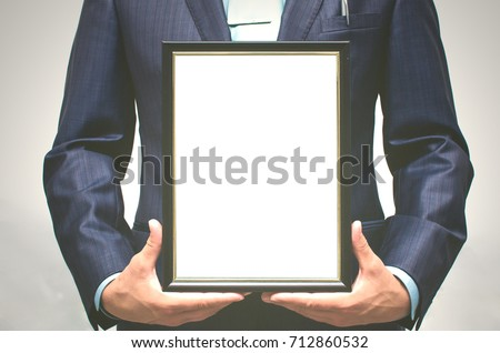 Special offer. Top manager award mockup. Best office employee award. Business man holding in hands empty blank photo frame. Gratitude concept. Grateful letter. #712860532