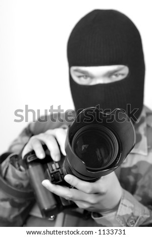 Special Ops Photographer. Lens hood and front of lens are in focus, rest is soft . B&W