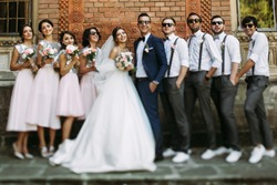 Special photo of the couple with the friends on the wedding