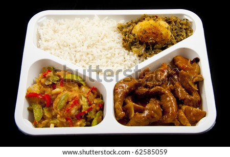 Special plate with indonesian food isolated over black