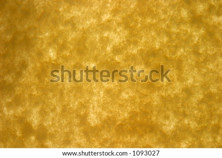 special recycled yellow paper held lit up with sunlight for backgrounds