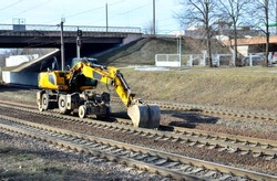 Special wheel excavator for work on the rails of the railway