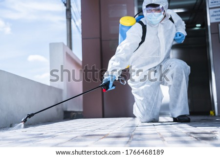 Specialist man in virus protective suite and mask spraying alcohol cleaning covid19 infected area, Virus disinfection concept Photo stock ©