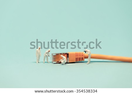 Specialists with network cable. Macro photo
