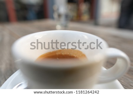 Specialty coffee espresso cup and crema  , close-up view empty space for your logo montage on inside cup, very best positon for marketing
