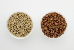 Specialty green and roasted coffee beans from Kenya on a white background. Top view