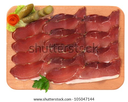 Speck on wooden board
